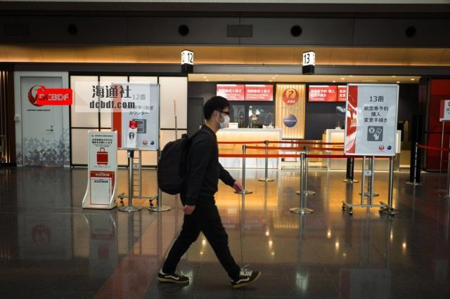 前往日本的完全接种过疫苗的旅客将缩短COVID-19隔离期